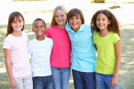 foto of children playing  - Portrait Of Group Of Children Playing In Park - JPG