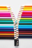 Set Of Colored Pastel Pencils In Row Multi Color In Form Of Open Zipper And Pencil Sharpener Concept poster