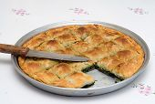 Traditional Spinach Pie And A Knife From Northern Greece