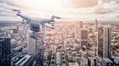 multicopter drone flying over the city of Frankfurt am Main, Germany poster