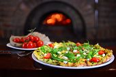 Tasty Pizza In A Traditional Restaurant With A Fire Stone Stove. Background With A Tasty Food. poster