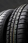 Protector Of Automobile Tires. A Number Of Automobile Tires. Close Up View On Auto Mobile New Wheel  poster