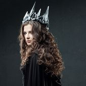 Portrait Of A Gothic Princess. Beautiful Young Brunette Woman In Metal Crown And Black Cloak. Mystic poster