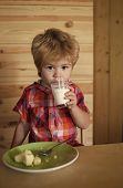 Small Boy Child Eat Banana And Drink Milk. Healthy Food And Vitamin. Childhood And Happiness, Indepe poster