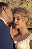 Tender Beautiful Wedding Couple Of Man Touching And Kissing Blonde Girl With Closed Eyes And Red Lip poster