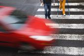 stock photo of pedestrian crossing  - a crosswalk with red car and two pedestrian - JPG