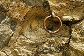 Rusted Ring Embedded In Stone