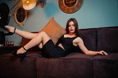 Perfect, Sexy Body, Legs Of Young Woman Wearing Black Dress.sensual Girl Posing On Sofa In Erotical poster