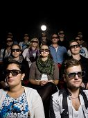 People Wearing 3D Glasses At Cinema