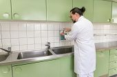Male Doctor Or Surgeon Is Disinfecting His Hands With Disinfection Fluid In A Hospital Or Private Pr poster