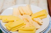 Sliced Cheese On A Plate. Cheese Sliced. Cheese Close-up. Slices Of Cheese On A Plate. poster