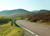 image of long winding road  - country road winding through the Scottish Highlands - JPG