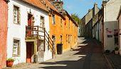 A street in Culross.  The town of Culross is a former royal burgh in Fife, Scotland.