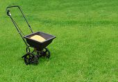 stock photo of spreader  - Fertilizer spreader kit on the lawn yard - JPG