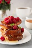 French Toasts, French Toasts Made Of Sliced Brioche With Fresh Raspberries, Honey And Mint. Deliciou poster