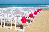 White wedding chairs on the beach