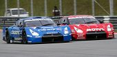 SEPANG - JUNE 10: Two Nissan GT-R cars race at the 2012 Autobacs SUPER GT Series Round 3 on June 10,