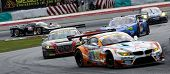 SEPANG - JUNE 10: GT300 cars take turn 1 at the 2012 Autobacs SUPER GT Series Round 3 on June 10, 20