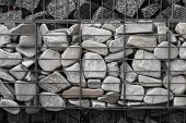 A Stone Wall That Uses Metal And Stone In Harmony. Ecology Friendly Using A Natural Resourses For Co poster
