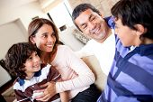 stock photo of happy family  - Family talking and a boy telling a story - JPG