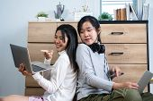 Asian Girl Listening Music And Learning E-learning With Headphones, Smiling Happy Searching Songs Mo poster