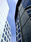 White Office Buildings With Blue Windows