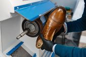 Shoemaker processes sole of shoe, footwear repair poster