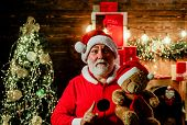 Happy New Year. Christmas Decoration. Santa Man With Toy Teddy. Merry Christmas. Christmas Holidays. poster