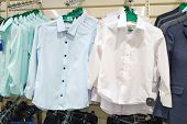 A Large Selection Of Childrens Clothing For Boys In A Branded Store. A New Collection Of Fashionable poster