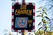 Digital Speed Limit Sign In Germany Shows Car Driver Speed Measurement. (translation you Drive... M poster