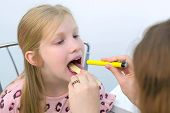 Medicine For Children And Healthcare Concept. Pediatrician Looking Child Girl Throat Using Spatula A poster