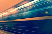 Subway Train In Motion. Departure Of The Train From The Station. Long Exposure Photo. Motion Blur poster