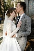 Attractive Couple Celebrating Their Wedding In Forest. Portrait Of Young Happy Groom And Bride In We poster