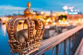Stockholm, Sweden. Skeppsholmsbron - Skeppsholm Bridge With Its Famous Golden Crown In Night Lights. poster
