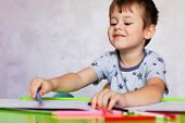Little Boy Drawing With Color Pencils. Boy, Drawing A Picture For Fathers Day. Small Boy Draws At Th poster