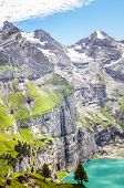 Vertical Photo Of Beautiful Oeschinensee Lake By Kandersteg, Switzerland. Turquoise Lake Surrounded  poster