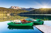 stock photo of cloud forest  - Reflection in water of mountain lakes and boats - JPG