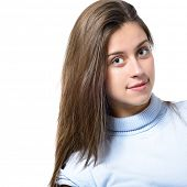 portrait of attractive teenager girl smiling with long brown hair in cheerful mood in blue t-shirt, over white