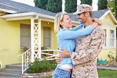 stock photo of army  - Wife Welcoming Husband Home On Army Leave - JPG