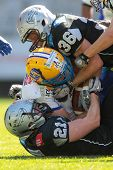 INNSBRUCK, AUSTRIA - APRIL 28: LB Alex Gross (#37 Giants) is tackled by DB Markus Krause (#21 Raider