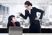 stock photo of rude  - Businesswoman is yelling at her employee in the office - JPG