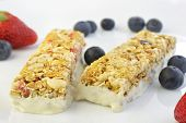 picture of roughage  - Granola bars with berries on a blurry background - JPG