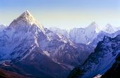 stock photo of snow capped mountains  - Spectacular mountain scenery on the Mount Everest Base Camp trek through the Himalaya mountains Nepal - JPG
