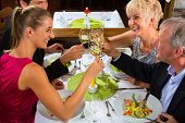 Family, mother and father with adult children and daughter or son in law �?�¢??fine dining in nic