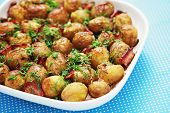 bowl of roasted potatoes with bacon and dill - food and drink /shallow DOFF/