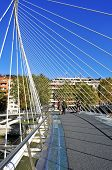 BILBAO, SPAIN - NOVEMBER 13: Zubizuri Bridge on November 13, 2012 in Bilbao, Spain. This tied arch f