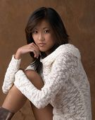 Asian Woman Sitting In Sweater
