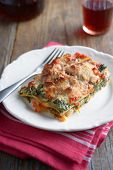 Lasagna with spinach, ricotta, and tomatoes