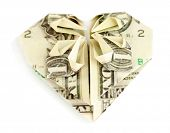 Dollar folded into heart isolated on white