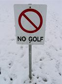 No Golf Sign Surrounded By Snow